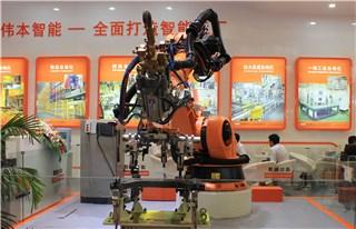 Robot spot welding & handling automation